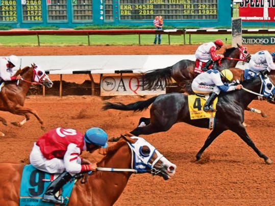 Terry Stennett's Tres Friends held off the charge of Ruidoso Futurity winner First Valiant Sign to take the Grade 1, 1 million Rainbow Futurity at Ruidoso Downs on Sunday afternoon.