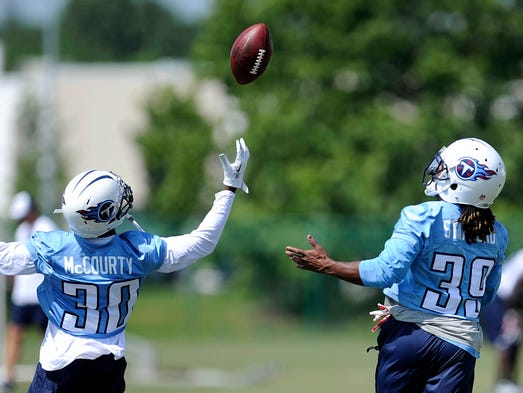 Cornerback Jason McCourty (30) and safety Daimion Stafford (39) try to catch a pass  during the Titans'  final minicamp practice on June 19, 2014, at Saint Thomas Sports Park.