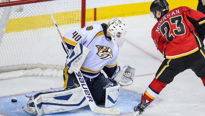 Calgary Flames center Sean Monahan scores a shootout goal against Nashville Predators goalie Devan Dubnyk.
