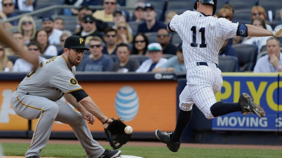 Pirates first baseman Ike Davis scoops up a low throw to the bag ahead of the Yankees'  Brett Gardner during the first inning of  Saturday's game. Gardner was ruled out on the play.