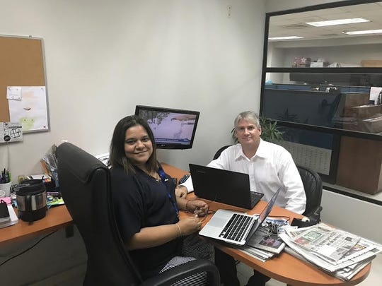 J. Scott Bronstein and his wife, Rita Vasquez, work in their office at  La Prensa in Panama City, Panama.