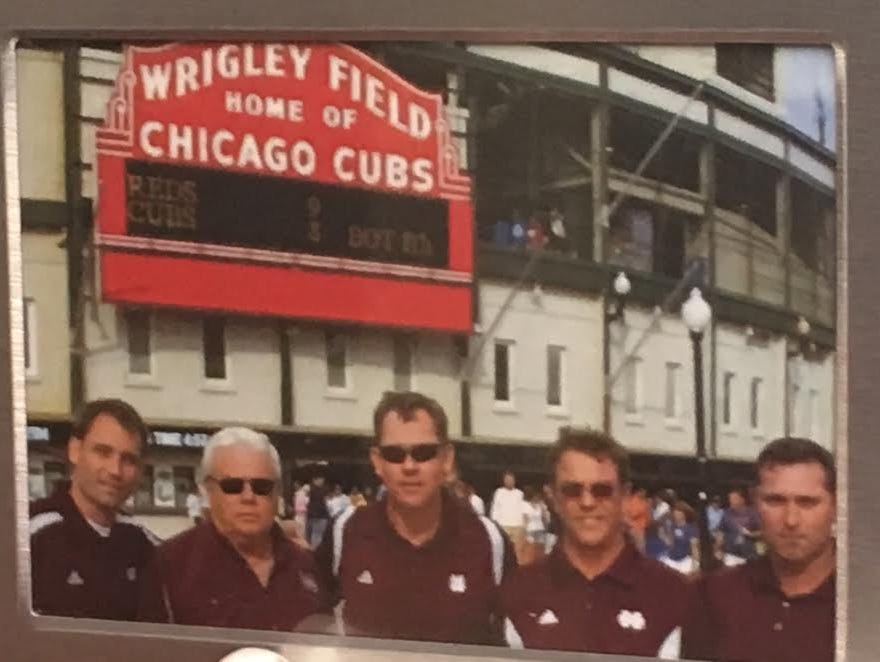 This photo sits near the desk of Auburn head coach Butch Thompson. In the photo is then-Mississippi State head coach John Cohen (center) and Thompson (far right) outside of Wrigley Field.
