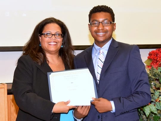 Ivan Jubilee of Painted Post receives his certificate from Program Manager Celia Williams-Fowlkes for completing the Howard University College of Pharmacy Center of Excellence High School Summer Enrichment Science Academy.