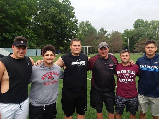Wayne Hills football captains (from left) Joe Rondi, Anthony Puntolillo, Bence Polgar, coach Wayne Demikoff, Joseph Mongelli and Jaaron Hayek.