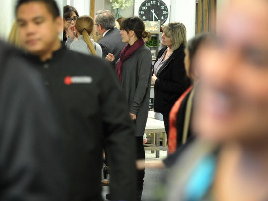 A crowd of people toured the hallways of the new Wichita