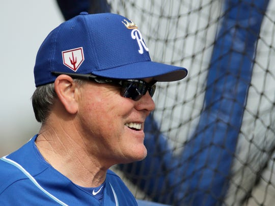 Kansas City Royals manager Ned Yost watches batting practice during spring training baseball practice Friday, Feb. 15, 2019, in Surprise, Ariz. (AP Photo/Charlie Riedel)