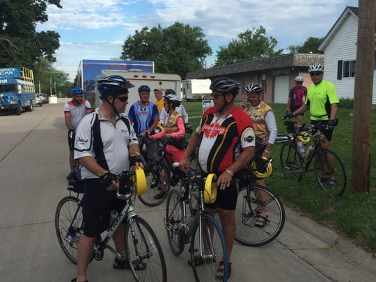 "James Foley, 67, of Jacksonville, Fla., right, was hit and dragged by a truck on July 24, 2016. He is pictured with his RAGBRAI team ""Foley Boys"" in 2015, with his nephew, Corey Brick, on the left."