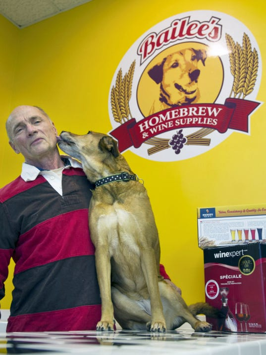 Bob Elmiger poses with his dog Bailee at Bailee's Homebrew & Wine Supplies in Springettsbury Township. Bailee's is one of five new locations on the Susquehanna Ale Trail that will offer beer samples during the Brewmaster Tasting Tour April 10-12 and 17-19.