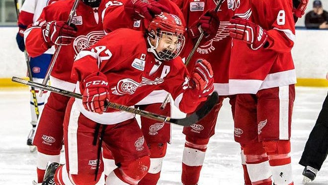 Northville's Nick Robertson, front, celebrates a goal with the Toronto Red Wings in the Greater Toronto Hockey League.