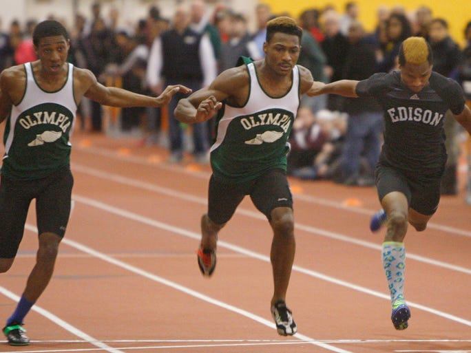 Greece Olympia's Carnell Noble, center wins the boys 55 meter dash beating out Edison's Daekwan Garfield, right, who took third, and Olympia's Tremaine Moore, left, who took fourth.