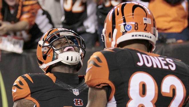 The future of Cincinnati Bengals free agent wide receivers Mohamed Sanu, left, and Marvin Jones could affect the way the team approaches the 2016 NFL Draft.
