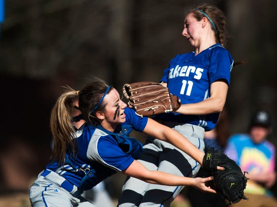 Colchester's Jordan Schrabel (7) collides with Brittany