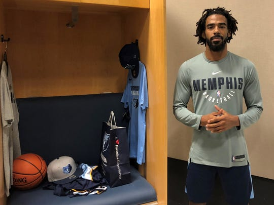"""In this Tuesday, Jan. 9, 2018 photo, Memphis Grizzlies guard Mike Conley talks about the influence on today's society of civil rights leader Martin Luther King Jr.  in Memphis, Tenn. When Dr. Martin Luther King Jr. said returning hate for hate multiplies hate, adding deeper darkness to a night devoid of stars, he wasn't thinking of the world in 2018. More than a half-century later, amid contentious political fights, one of King's memorable quotes from his book """"Strength to Love"""" remains relevant. (AP Photo/Adrian Sainz)"""