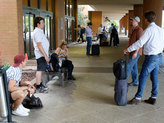 Passengers, who were on United Airlines Flight 1239 headed from Miami to Chicago O'Hare, wait at Tallahassee International Airport after their flight made an emergency landing.