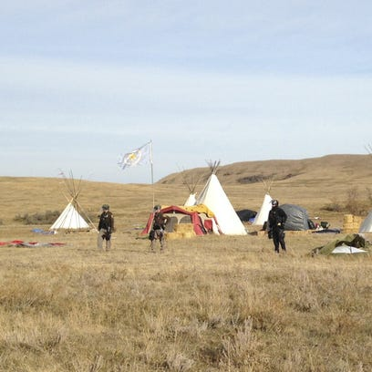 Dakota Access pipeline protester and law enforcement