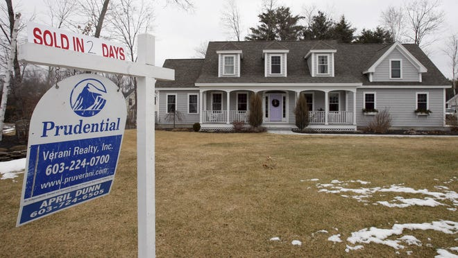 "In this Feb. 23, 2010 photo, a ""Sold in 2 Days"" sign is seen at a home for sale in Concord, N.H. Sales of previously occupied homes took a large drop for the second straight month in January, falling to the lowest level since summer. It was another sign the housing market's recovery is faltering. (AP Photo/Jim Cole)"