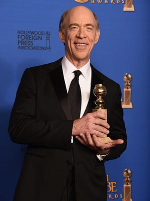 "J.K. Simmons poses in the press room with the award for best supporting actor in a motion picture — drama, musical or comedy for ""Whiplash"" at the 72nd annual Golden Globe Awards at the Beverly Hilton Hotel on Sunday, Jan. 11, 2015, in Beverly Hills."