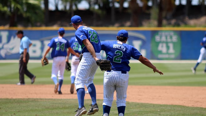 FGCU's Tyler Selesky and Nick Rivera celebrate Thursday's 6-2 win over Kennesaw State in the Atlantic Sun Conference Tournament at Swanson Stadium.