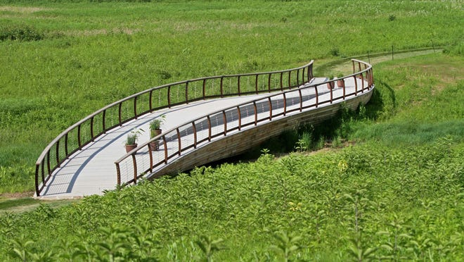 A bridge in the shape of ships hull sits in the middle of the 86-acre Meadow Garden at Longwood Gardens. Longwood is offering fellowships to professionals who want to pursue a career in public horticulture.