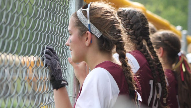 BFA-Fairfax players cheer on their teammates from the dugout during Wednesday's Division II softball semifinal against Milton.