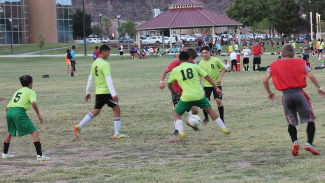 Bulldogs, from left, David Cabrera, Rafael DeSantiago, Roman Perez and Jay Gomez surround an opponent last Tuesday during a match.