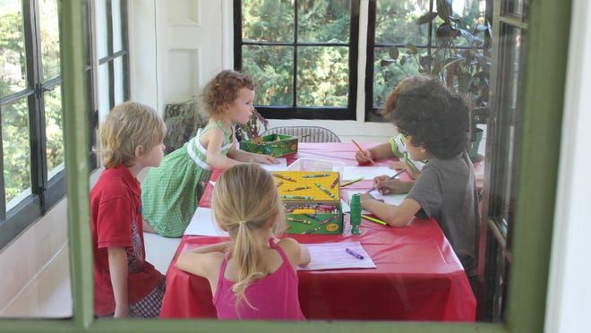 A group of kids participates in a craft during a Kids' EDventure at Historic Deepwood Estate. The home offers the classes through the summer.