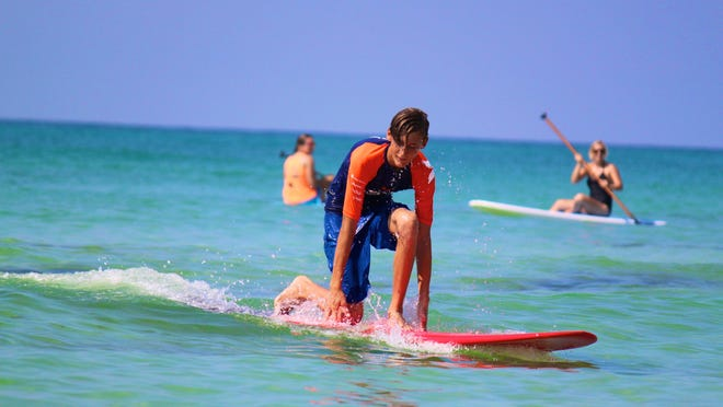 The Mauli Ola Foundation brought pro surfers to Pensacola to assist children with various genetic diseases. The nonprofit organization is dedicated to using water-based activities as treatment for those children with genetic diseases such as cystic fibrosis.