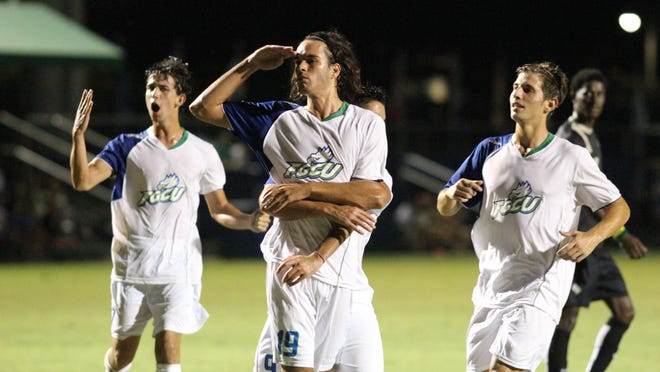 FGCU forward Rielle Mohsin, center, salutes in celebration of his second-half goal against UCF on Wednesday night.