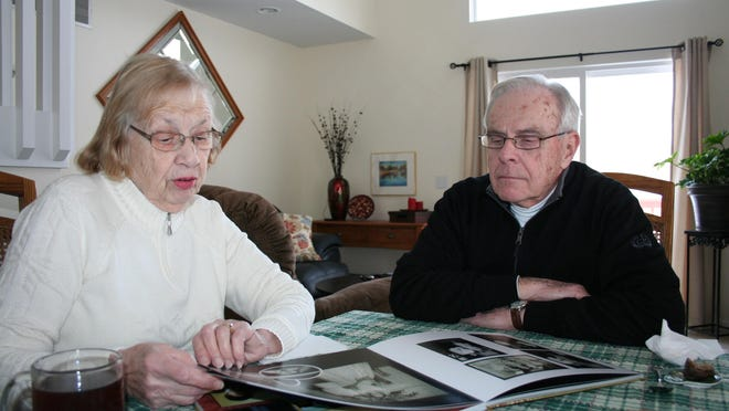 Carol and David Hockenbrocht of Jackson look over the pages of their photo book.