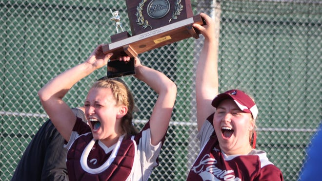 Bryanna Williams, left, and Lindsey Bergeron lift the Division II softball state championship plaque after Lyndon defeated Mount Abraham in Friday's title game.