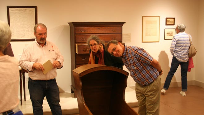 Visitors at the Rokeby Museum take a closer look at a cradle Stephen Foster Stevens made for the Robinsons in 1823.