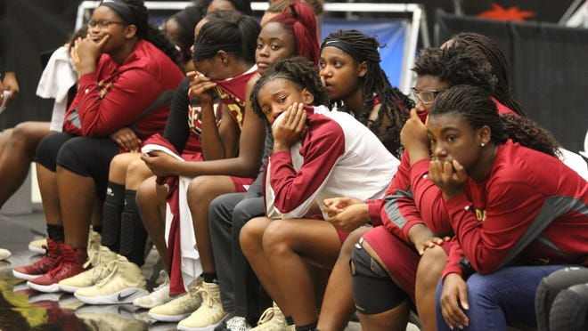 Florida High's girls basketball team reacts to the scoreboard as Orlando Jones pulled away to a 56-44 win in the 2017 Class 5A state championship game.