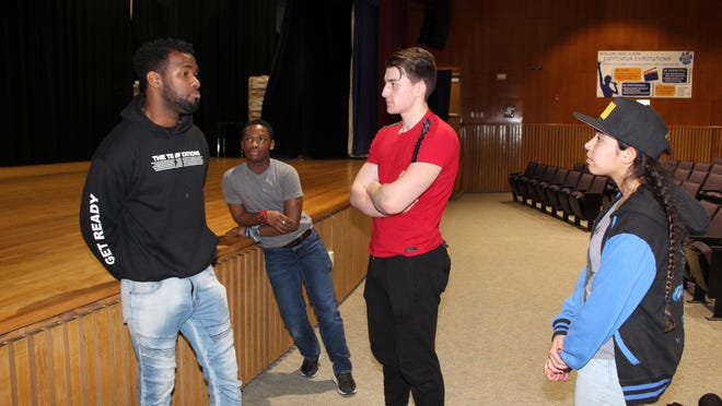 """Highland High School students converse with """"Hamilton"""" star Chaundre Hall-Broomfield after his presentation. The actor gave the students advice on how to be successful as an actor in the professional theatre world. From left, Chaundre Hall-Broomfield, Wilfred Jones, Jr., Chris Bell, and Brianna Acosta."""