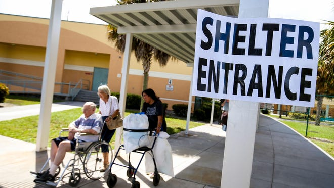 Residents arrive at the Independence Middle School shelter in preparation for Hurricane Irma in Jupiter on September 8, 2017.
