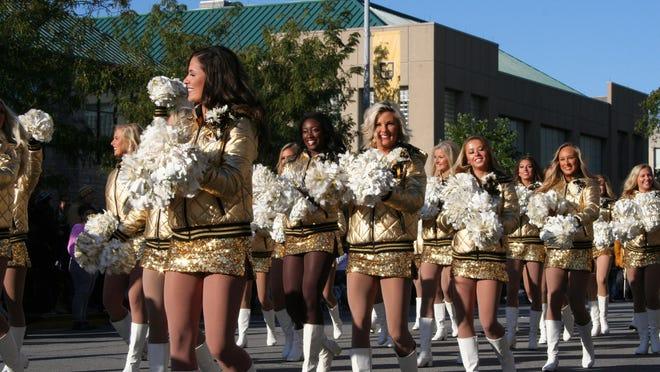 Mizzou's Golden Girls walk down Rollins Street during the 2019 University of Missouri Homecoming Parade.