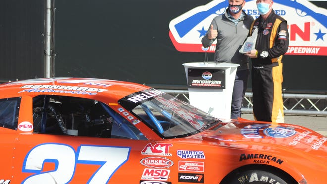 Dover's Wayne Helliwell Jr. celebrates in Victory Lane after winning Saturday's American Canadian Tour race at New Hampshire Motor Speedway.