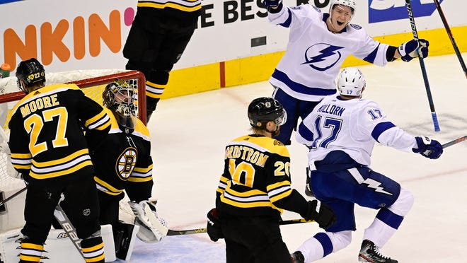 Lightning center Alex Killorn (17) celebrates his goal, and the team's fourth of the night, against Bruins goaltender Jaroslav Halak, with teammate Ondrej Palat during the second period Wednesday night.