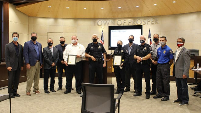 During the Sept. 22 Prosper Town Council meeting, proclamations were made declaring October as Fire Prevention Month and Oct. 6 as National Night Out. Shown from left to right are Mayor Ray Smith, Council Member Craig Andres, Council Member Jeff Hodges, Council Member Marcus Ray, Fire Chief Stuart Blasingame, Police Chief Doug Kowalski, Officer Erica Fairchild, Council Member Curry Vogelsang, Corporal Jeff Hoover, Detective Sergeant Paul Boothe, Chaplain Isaac Varela and Council Member Meigs Miller.