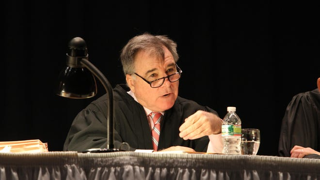 Supreme Court Justice Francis X. Flaherty is shown in a 2011 file photo. The court was hearing arguments at Classical High School.