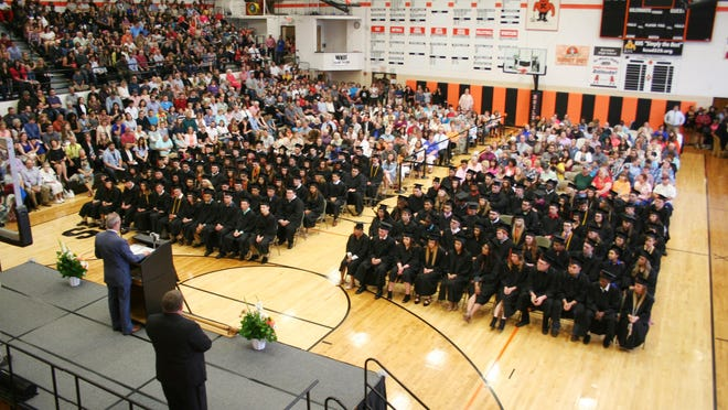 Kewanee Dist. 229 students and their family members listen to Supt. Chris Sullens deliver remarks at the school's 2018 graduation ceremony.