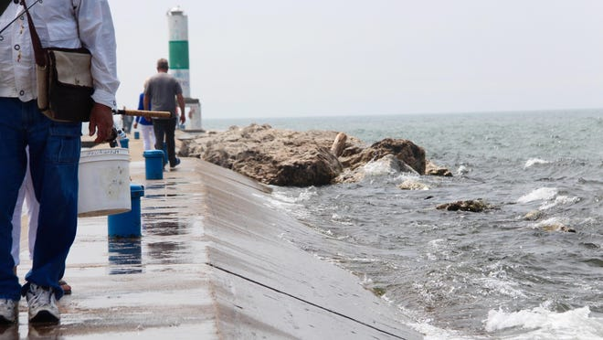 The pier at Holland State Park is a source of concern for local officials as the park heads into the height of summer beach season with Lake Michigan water levels high.