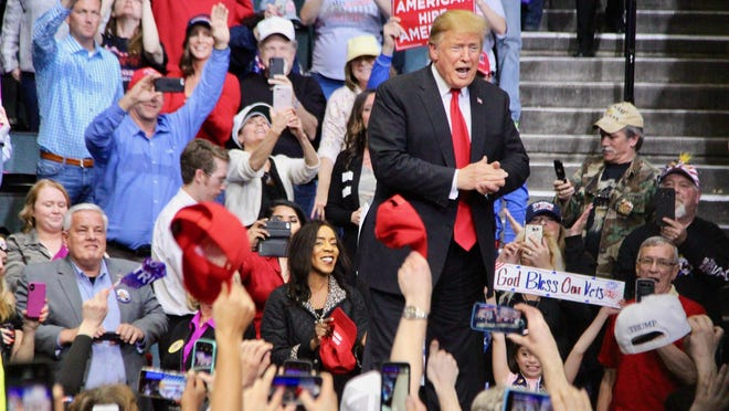 President Donald Trump greets the crowd at Van Andel Arena during his 2020 re-election campaign stop March 2019 in Grand Rapids.