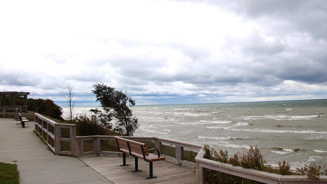 High winds and massive waves batter the Lake Michigan coastline on Tuesday, Oct. 22, 2019. A bill to update the environmental sensitivity index maps for the Great Lakes has been signed into law.