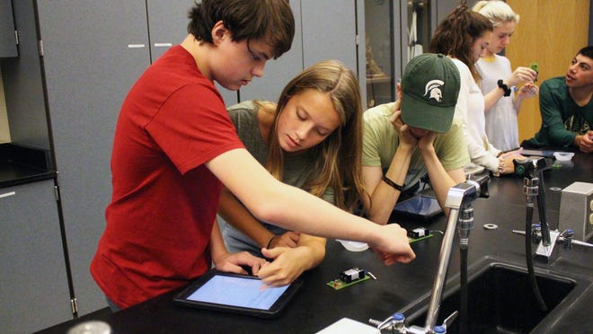 Students work in one of the science labs at Zeeland West High School. On Monday, Aug. 17, the Michigan House of Representatives passed a series of bills addressing schools returning in the fall in light of the coronavirus pandemic.