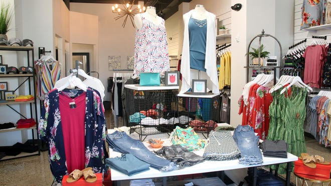 Clothes are prepared for customers to view at Hawthorne Collection's opening in late 2019. The storefront will move to a new location on Eighth Street and operate under a new name.