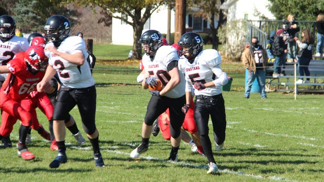 Craig Court runs the football against Tekonsha Saturday. Coldwater Daily Reporter/Troy Tennyson Photo