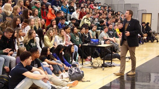 West Ottawa High School principal Jason Reinecke addresses students on Wednesday, May 1, 2019. K-12 school districts and higher education institutions are left planning for the fall with many unanswered questions about if, how and when they'll be able to resume in-person classes..