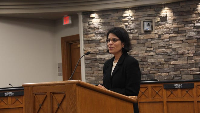 Esther Fifelski, pictured here presenting the Human Relations Commission's social justice awards in 2019, will soon be the city's human relations director instead of the human relations coordinator. The title change goes into effect July 1.
