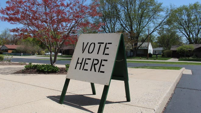 A vote here sign is pictured outside a voting location in Holland in May 2018. {Sentinel file]