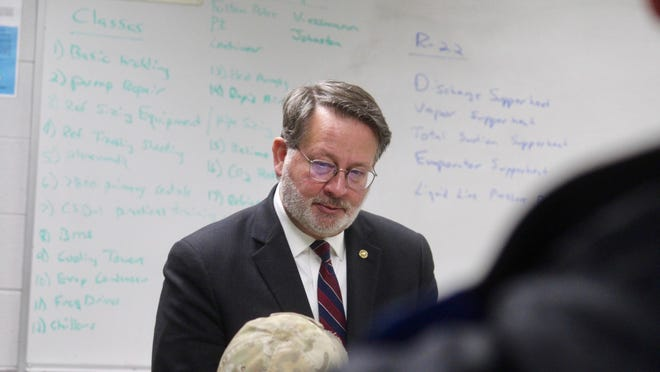 U.S. Sen. Gary Peters speaks to a trades apprentice during a tour of UA 174's Coopersville facility on in Feb. 2020.